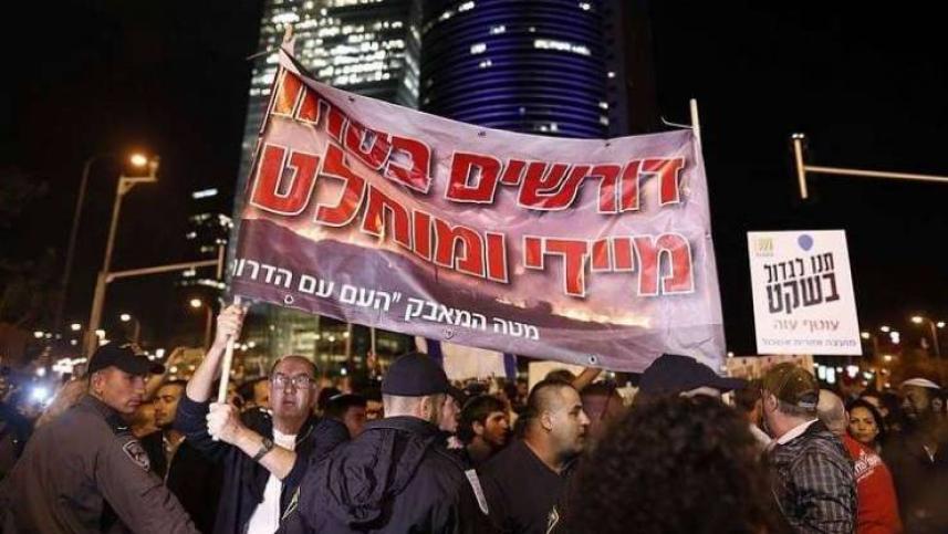 خلال التظاهرة في تل أبيب