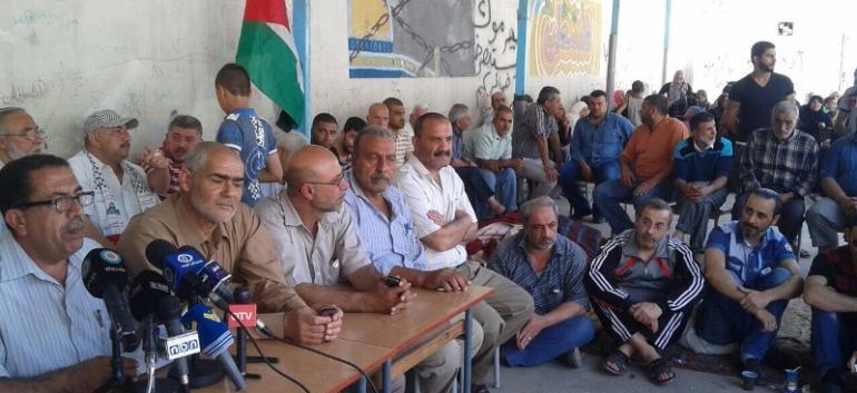 خلال المؤتمر الصحفي في مخيم البداوي